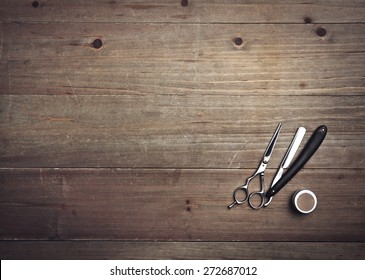 Vintage barber tools on wood background