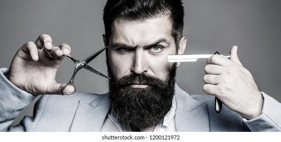 Vintage barbershop, shaving. Portrait beard man. Beard man, bearded male. Barber scissors and straight razor, barber shop. Brutal guy, scissors, straight razor. Black and white.