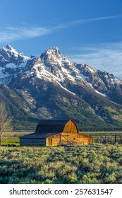 Vintage barn sits in front of the Grand Teton Mountains, Wyoming.