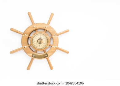 Vintage barometer in the shape of a steering wheel, isolated on white background. Flat lay, top view.