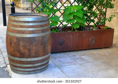 Vintage barrel on the side of a street in Chateauneuf-du-Pape, Provence-Alpes-Cote d'Azur, France