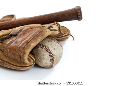 Vintage baseball bat, ball and glove isolated on a white background