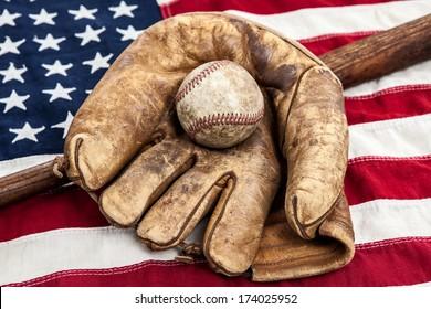 Vintage baseball, bat and glove on an American flag
