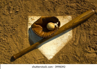 Vintage baseball with bat on home plate