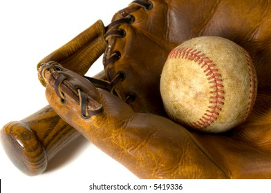Vintage baseball equipment on white background including a ball, a glove and a baseball bat