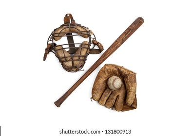 Vintage baseball glove, bat, ball and catchers mask isolated on a white background