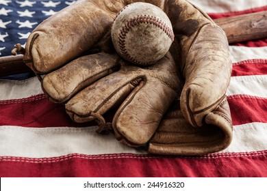 Vintage baseball, glove and bat on an American flag