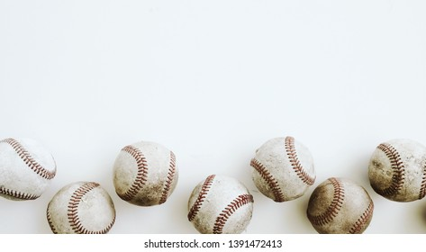 Vintage baseballs on white background for sports graphic, baseball top view of old used balls with copy space.
