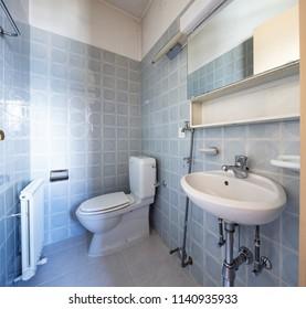 Vintage bathroom with blue tiles. Nobody inside