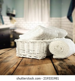 vintage bathroom interior and white towels on retro table top