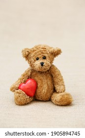 Vintage bear  with red heart. Love concept. Valentines Day.