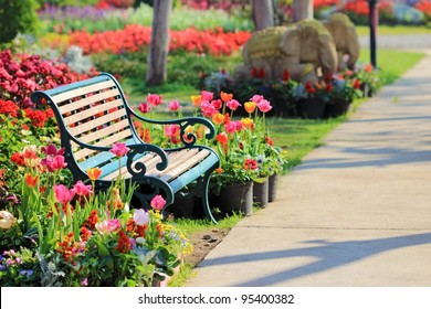 Vintage Bench in tulips garden