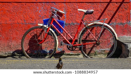 Vintage bicycle against old