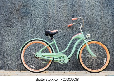 Vintage bicycle. Beautiful vintage bicycle standing near the wall
