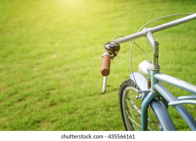 Vintage Bicycle and bell on the garden with sunlight