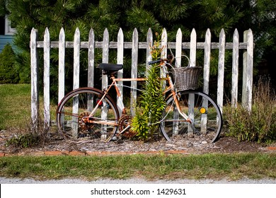 Vintage Bicycle by Fence