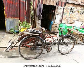Vintage bicycle (cyclos) in front of vintage house: Mergui, Myanmar