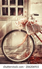 Vintage Bicycle with flowers  /summer background with bicycle (toned picture)