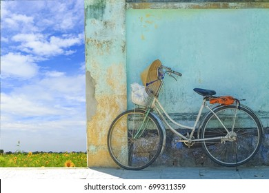 Vintage bicycle in front of the blue wall, background
