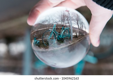 vintage bicycle in the glass ball, harbor