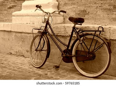Vintage Bicycle leaning on a wall in italian street