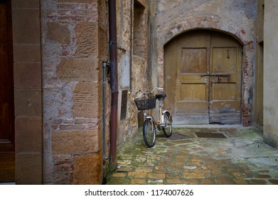 Vintage bicycle left on a charming streets of old Tuscany, Italy