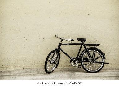 Vintage bicycle on old walls