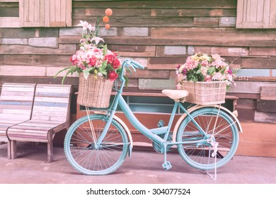 vintage bicycle on vintage wooden house wall with pastel color