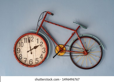 Vintage bicycle shaped wall clock hanging on the wall
