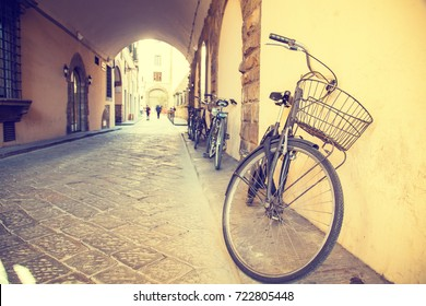 Vintage bike beside the street in Florence Italy