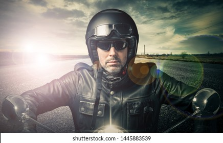 Vintage biker rolling on an isolated road