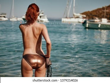 Vintage Bikini girl on the beach. woman in bikini on the beach on Adriatic Sea