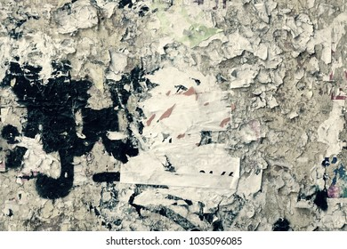Vintage Billboard With Torn Poster, Paper, Ads, Stickers. Grungy Dingy Backdrop Or Faded Texture. Abstract Grunge Horizontal Background. Urban Creative Creased Grungy Wallpaper Or Design Element.