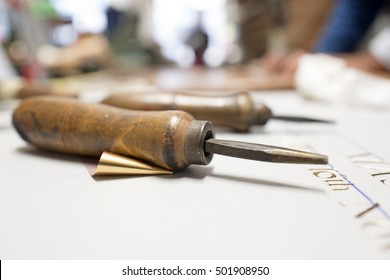 vintage bindery tools on a table work, in Milan.