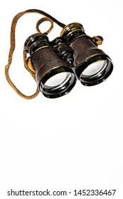 Vintage Binoculars isolated on a white background, top of frame in portrait orientation with room for text. Collectable object finished in leather and brass.