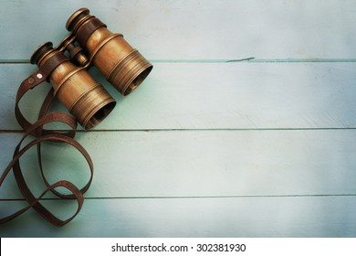 Vintage binoculars. Travel concept.