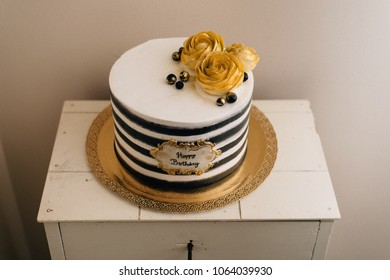 vintage birthday cake with golden roses and black stripes
