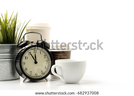 vintage black alarm clock with white coffee cup and Paper cup of hot coffee isolated white background, coffee breaks time