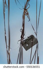 vintage black audio tape on blue background