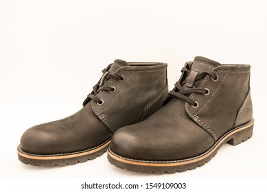 vintage black boots on white background, retro shoes