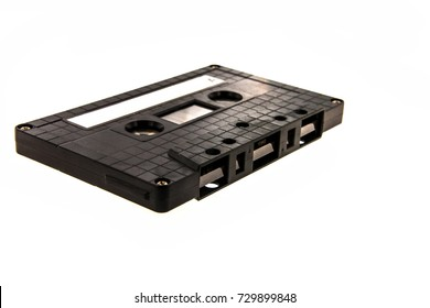 Vintage black cassette tape isolated on white background