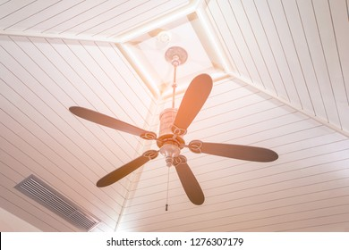 Vintage black ceiling fan with strip wood ceiling in hotel