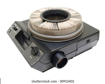 Vintage black circular slide projector with slides in tray.