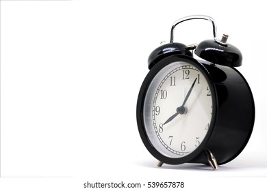 Vintage black clock ,Eight hours 5 minutes, on white background with copy space