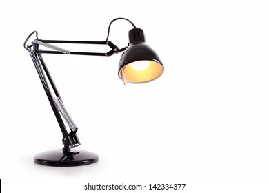 Vintage black desk lamp isolated on white