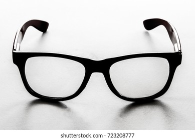 416b0d7a0 Vintage black glasses with its shadow on the white background, picture was  filtered in black
