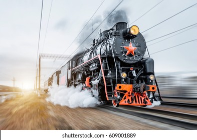 Vintage black steam locomotive train rush railway.
