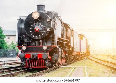 Vintage black steam locomotive train railway station