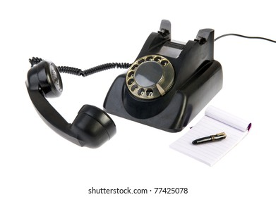 Vintage black telephone with numbers isolated over white