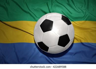 vintage black and white football ball on the national flag of gabon